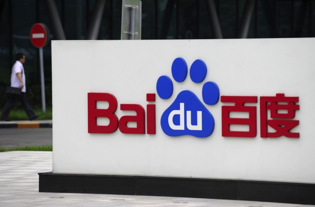 A man walks past the logo of Baidu at its headquarter in Beijing on July 22, 2010. Chinese Internet search giant Baidu said its profits more than doubled in the second quarter, as its customer base widened at the expense of rival Google. AFP PHOTO / LIU Jin (Photo credit should read LIU JIN/AFP/Getty Images)